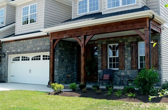 Exposed front porch beam and cedar shutters house for Cypress porch columns