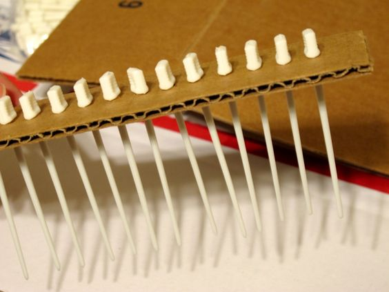 Its really easy to make your own raking combs for the swirl.  The one is the video was made using hair roller pix pushed through cardboard.  You can find roller pix at beauty supply stores or online.