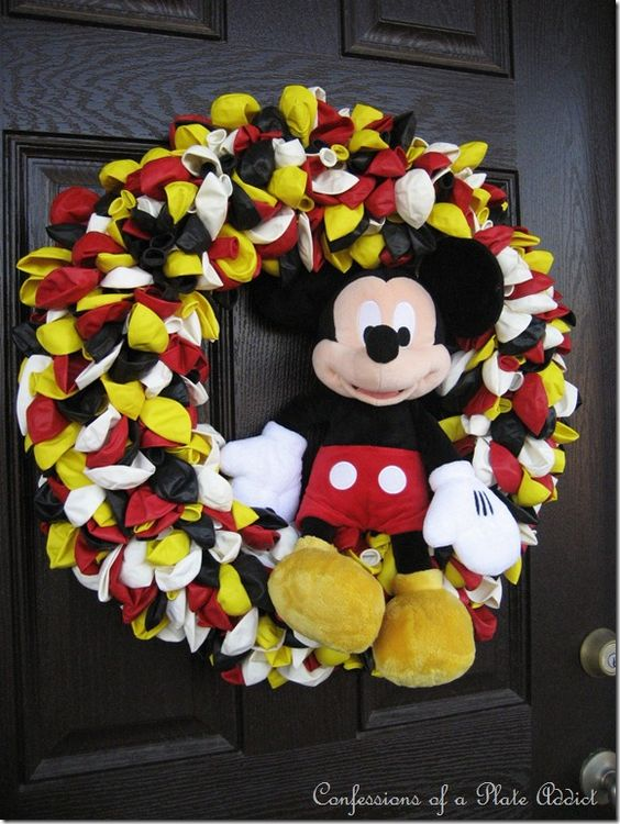 LOVE THIS!!!  You need a wreath form, greenery pins and 400 balloons in a mix of black, yellow, red and white.  Then you need some time...