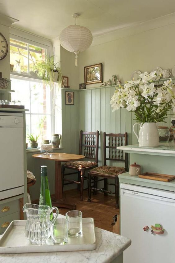 Put beadboard (instead) with a small ledge at the top 3/4 way up the wall in kitchen and extending into the dining area.