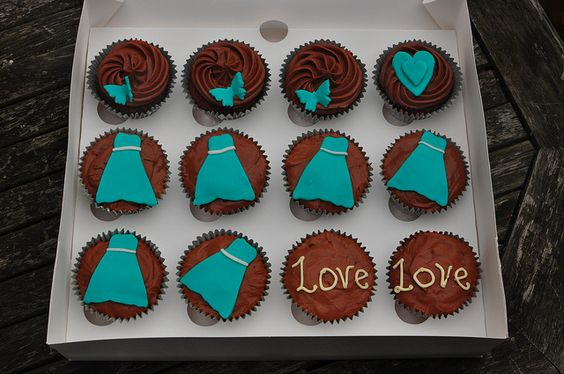 Turquoise and cream wedding cupcakes with handmade decorations by Little Miss Cupcakes