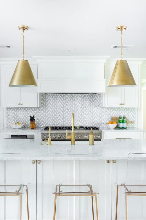 Clear Acrylic Counter Stools Sit At A White Marble Countertop Accenting A White Kitchen Island Finished Wit Kitchen Stools Kitchen Tiles Acrylic Counter Stools