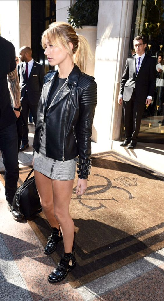 Love her shoes & leather jacket!