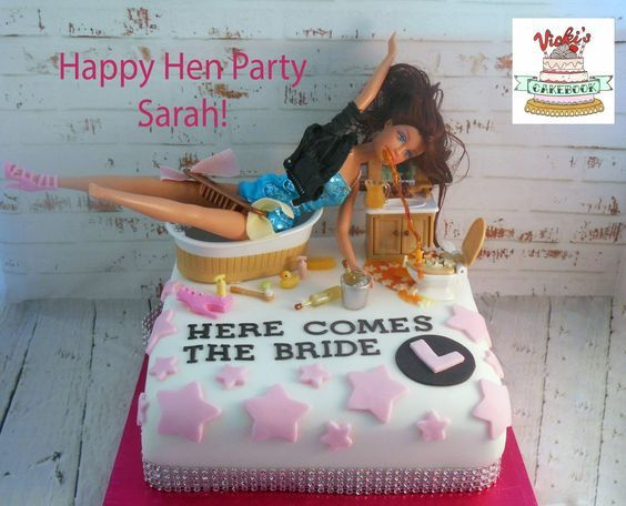 square cake saying here comes the bride with barbie doll on top in bath tub being sick - drunk barbie Drunk Barbie Hen Party Cake