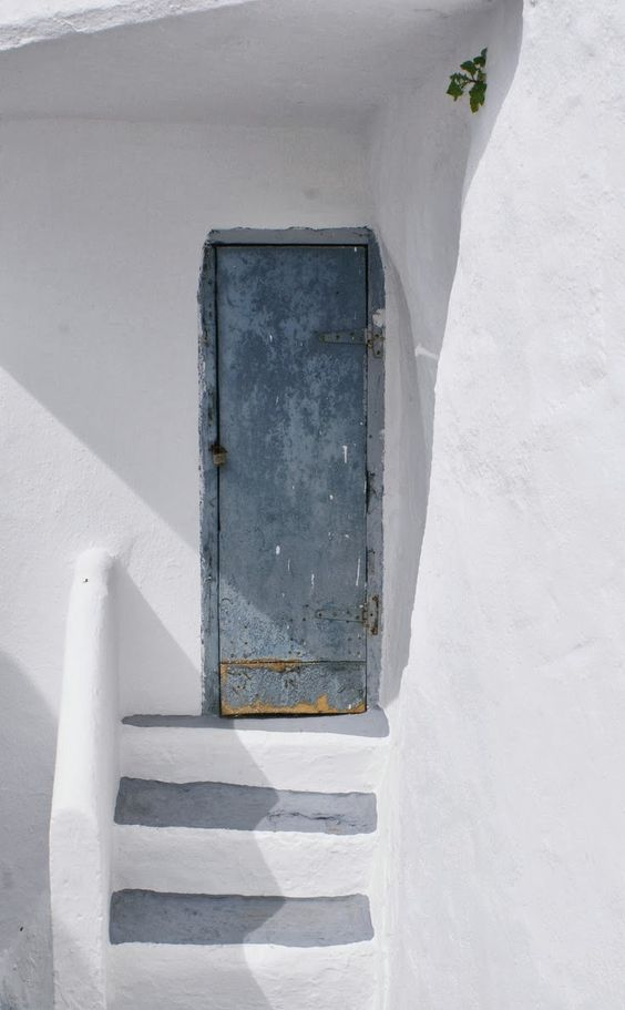 Whitewashed stairs and door