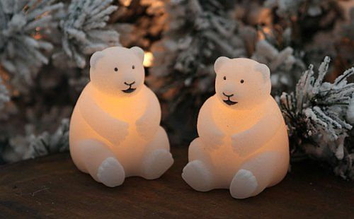 NII Candle Impressions Polar Bear Led Mini Candles, Set of 2 by Northern International. $12.95. Adorable set of 2 mini polar bears made of real textured wax. Each candle is 2.5 inches tall and 2.5 inches in diam. Flickers like a real candle. Safe, no drips, no mess. Can be left unattended. On Off switch on bottom CR2032 battery included 100 Hours run time Safe around children Perfect for your holiday decorating. Use to add a touch of light to your mantle, table decorations, en...