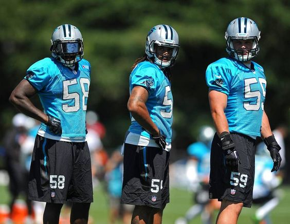 Carolina Panthers linebackers Thomas Davis, left, Shaq Thompson, center and Luke Kuechly, right, watch a play during practice at Wofford College in Spartanburg, SC on Saturday, August 1, 2015.