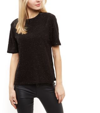 """Poppy Lux. Opt for sparkle for the party season with this metallic ribbed t-shirt. Pair with coated jeans and ankle strap heels to complete the look.- Metallic finish- Ribbed texture- Rounded neckline- Simple short sleeves- Zip back fastening- Casual fit that is true to size- Model is 5'8""""/176cm and wears UK 10/EU 38/US 6"""
