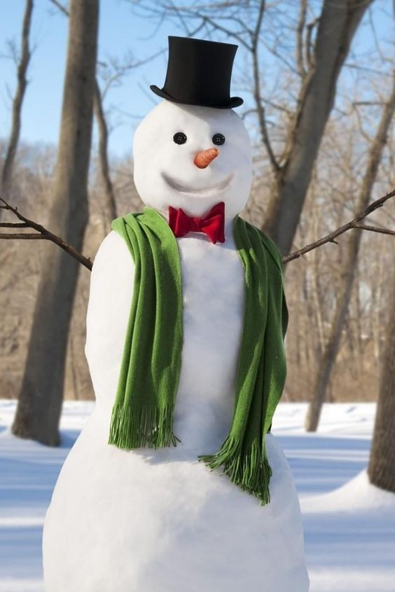 snowman with bow tie and scarf #snowSculpture #snow #winter #sculpture #snowman