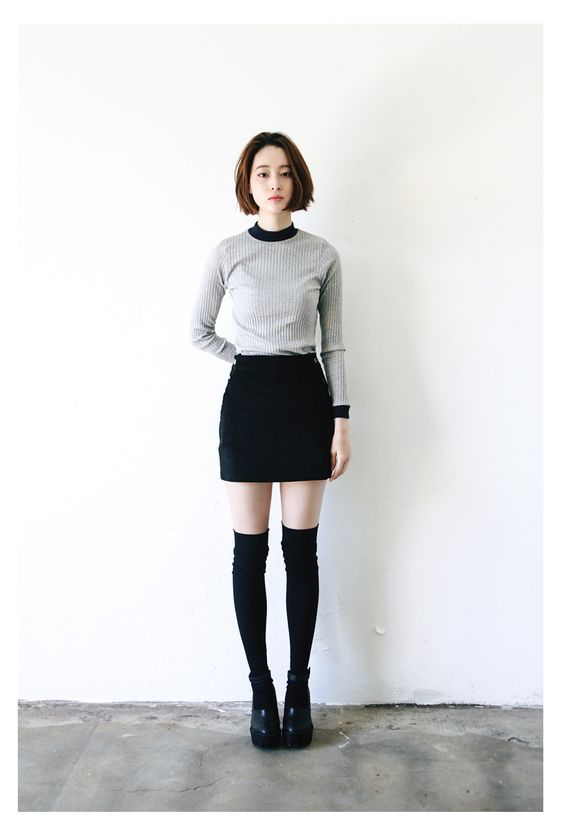 653077eeb But a pencil skirt and a conservative top give thigh-high socks an honorary  place in the office.