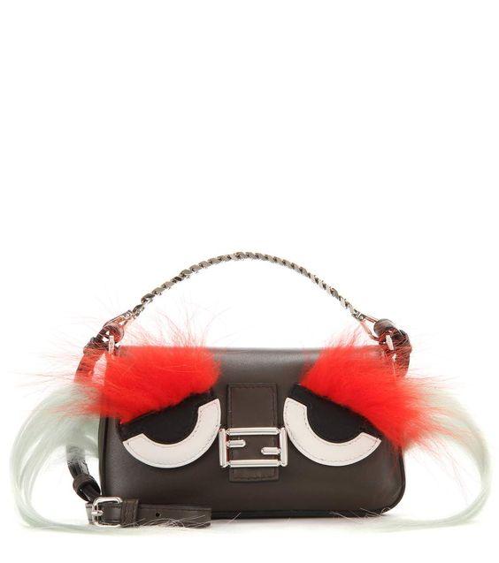 Fendi | Micro Baguette multicolored fur-trimmed leather shoulder bag.    Detachable shoulder strap, Magnetic fastening | Suede lining, internal slot pocket     Leather, fox fur, goat fur, Coal Tangerine Moon Palladium. Made in Italy