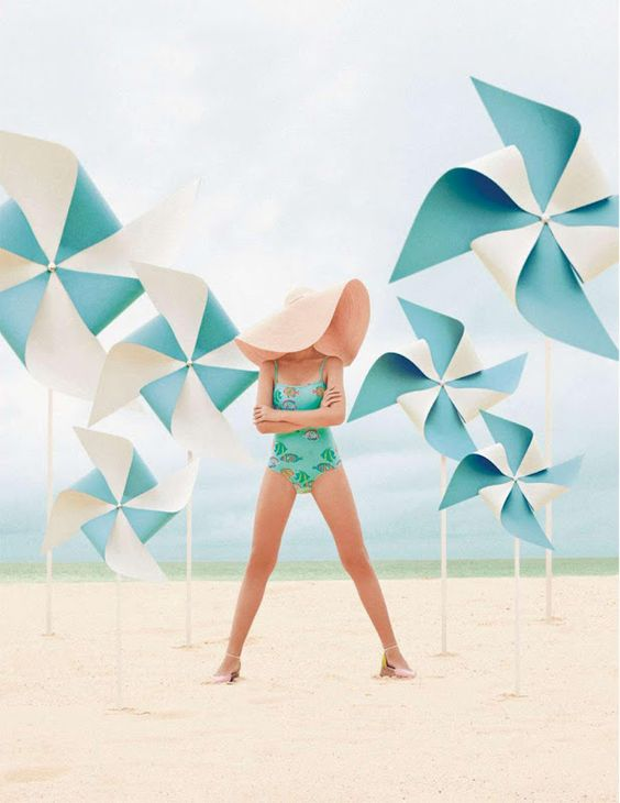 lovely teal, aqua, turquoise pinwheels on beach.  Love the floppy hat with the aqua swimsuit: