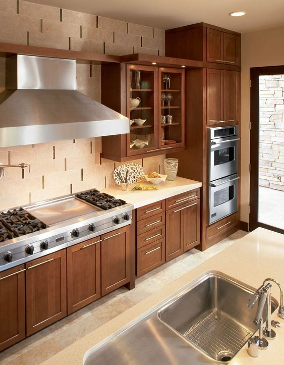 Warm Wood Kitchen With Cream Tile And Stainless Appliances Glass Doors Waypoint Living Spaces