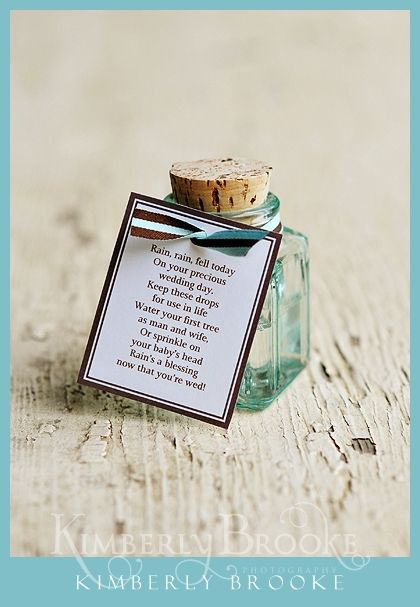 Rain Jar for a rainy wedding day idea and photo by Kimberly Brooke  Rain on your wedding? What seems like an inconvenience can be cherished forever! So I made a rain jar. I wrote a little poem, put it on a tag with ribbon and used one of my little square glass bottles with a cork. Collect rain on the wedding day and give to the couple!