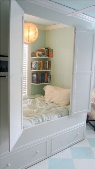 Mary, from Louisville Kentucky shared a photo of her childhood bedroom. I love the look of this little cupboard-like space. With the pillows and the books it looks perfect for a night's sleep or a nice long nap. #beds