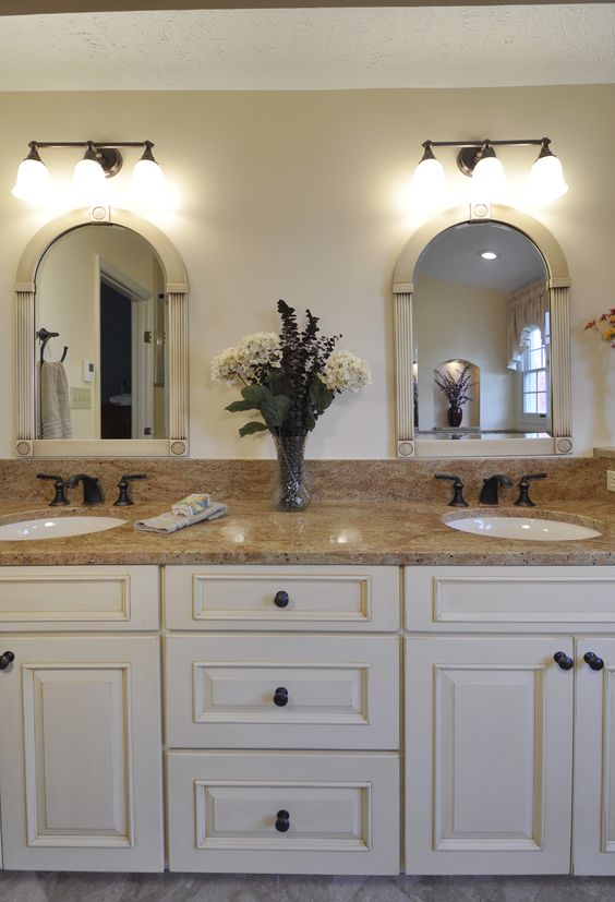 The Gracefully Arched Mirrors Are Topped With Lighting By