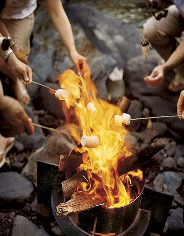 End a perfect evening with friends and family by enjoying s'mores around an open fire. All you need to make this summer-camp treat are bamboo sticks, graham crackers, chocolate, and marshmallows.: