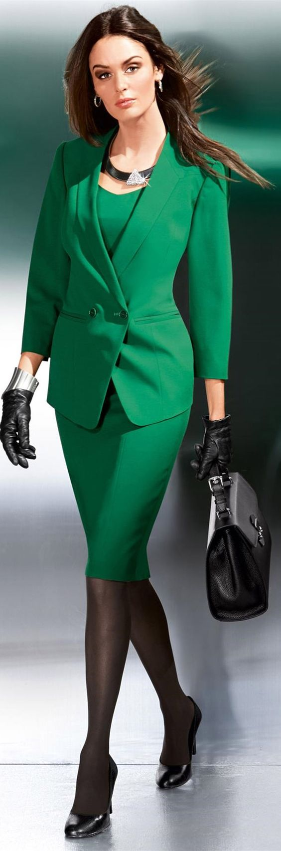 I love a simple shift dress paired with a classic jacket, the black hosiery and patent leather pumps really make the emerald green of this outfit stand out.