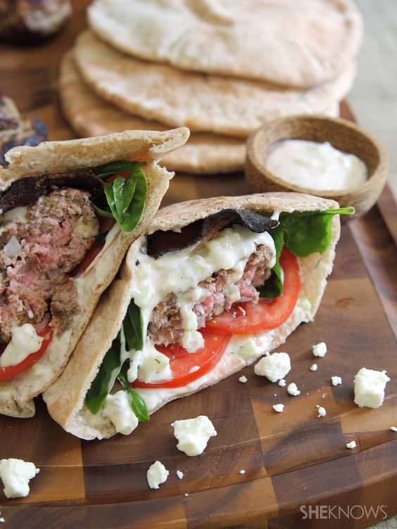 Feta-Stuffed Lamb and Bacon Pita Burgers with Spicy Tzatziki Sauce