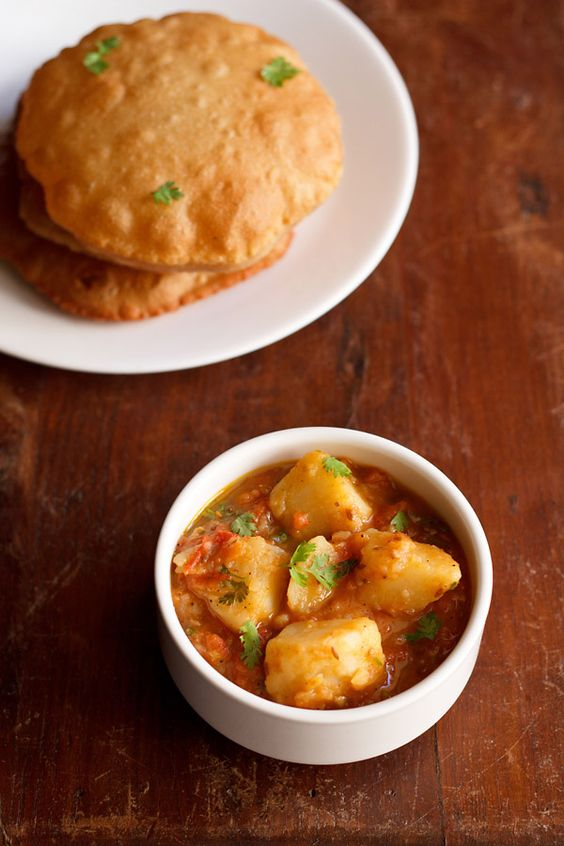 ... easy lightly spiced curry made with potatoes and tomatoes. #curry #