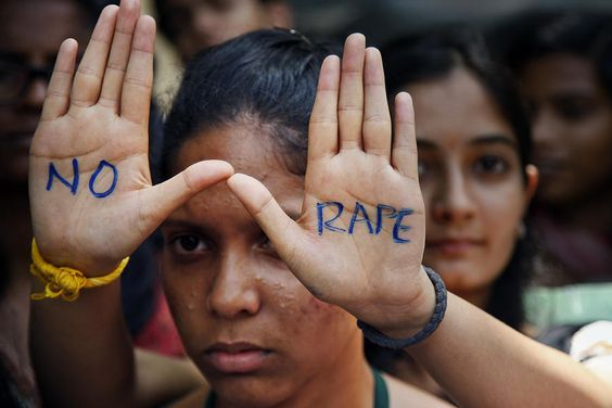 An Indian student displays a 'NO RAPE' message during a demonstration to demand death sentence for four men convicted of rape and murder of a female student.