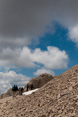 Hiking around the tumulus on summit of Mount Nemrut