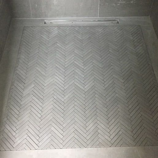 Work In Progress With A Custom Made Precision Inset Herringbone Slip Resistant Mosaic The Floorfalls Have To B Linear Drain Master Bath Shower Shower Floor
