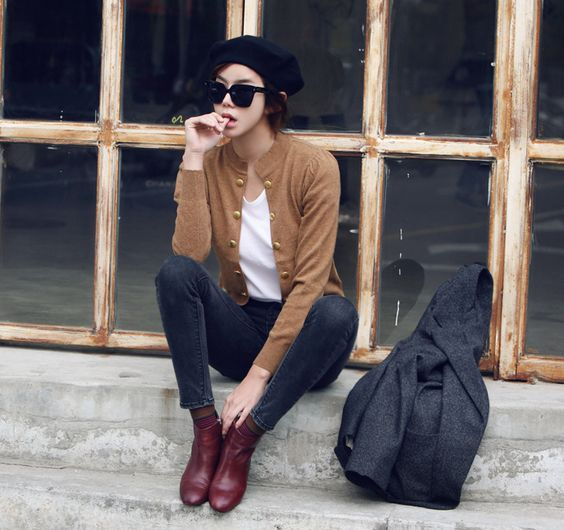 Skinny jeans, white t-shirt, brown or burgundy leather ankle boots, tan or beige cardigan, charcoal grey coat / jacket / blazer: