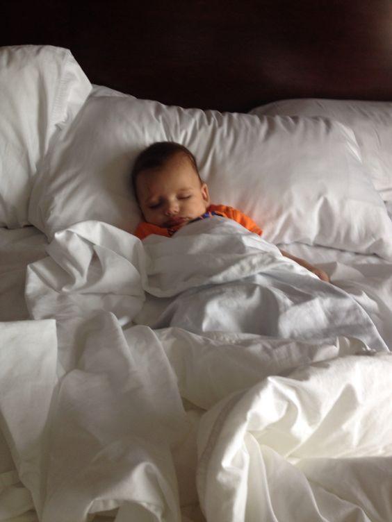 Sleeping in a big hotel bed