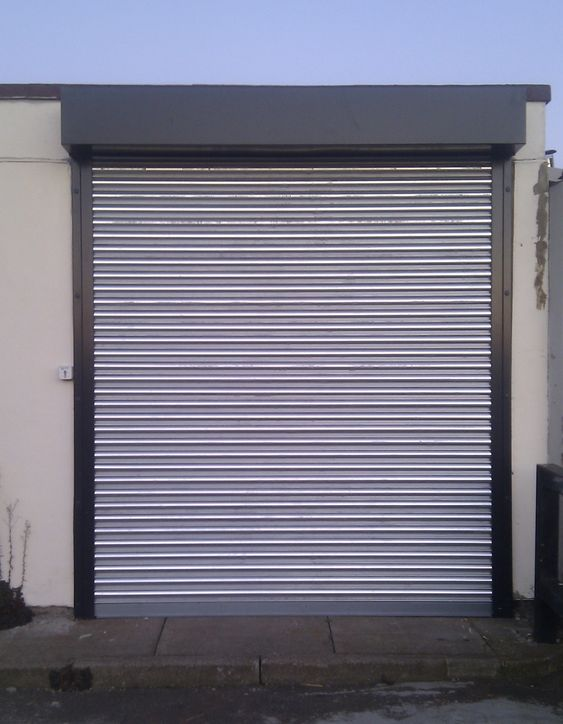 Rsg5000 Galvanised Security Roller Shutter Fitted To The Main Entrance Of An Office Unit In Harlow Roller Shutters Shutter Doors Rolling Shutter