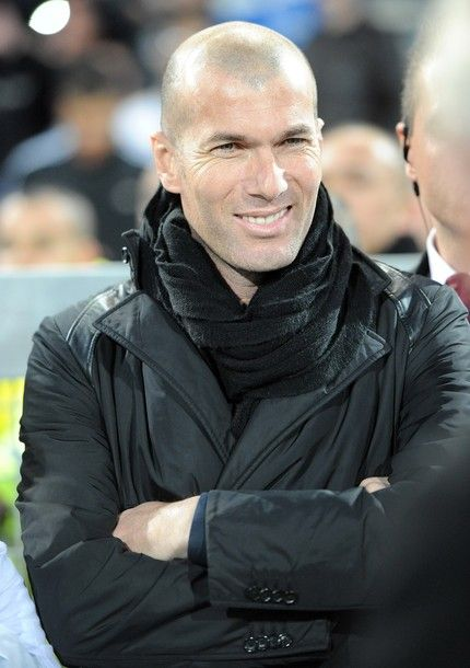 Usually for me to post a pix of a footballer he needs to be shirtless or be showing off some awesome leg muscles but not Zinedine Zidane...that smile...aww