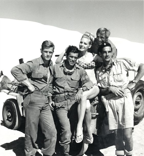 """Chris poses with """"The Rat Patrol"""" gang: (l) Larry Casey,(r) Gary Raymond, (b) Justin Tarr and occasional guest star, actress Janine Gary, 1966-68."""