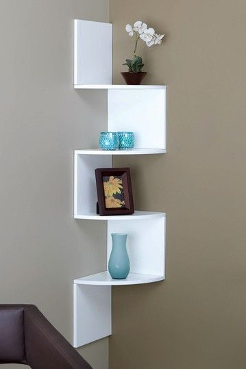 "Organize It by Nexxt  (Provo Wall Shelf  White). Retails for $129.  This stylish space-saving corner unit in white finish will create a lovely accent on your wall in addition to housing your favorite knick-knacks, picture frames, and more.   - Contoured hanging corner shelf   - Equipped with hardware for easy assembling  - Holds up to 20lb per shelf  - Approx. 12"" W x 57"" H x 12"" D"