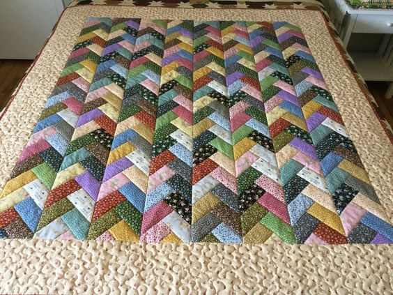 """This quilt used one jelly roll. The fabrics is from the """"Little House On The Prairie"""" fabric line"""