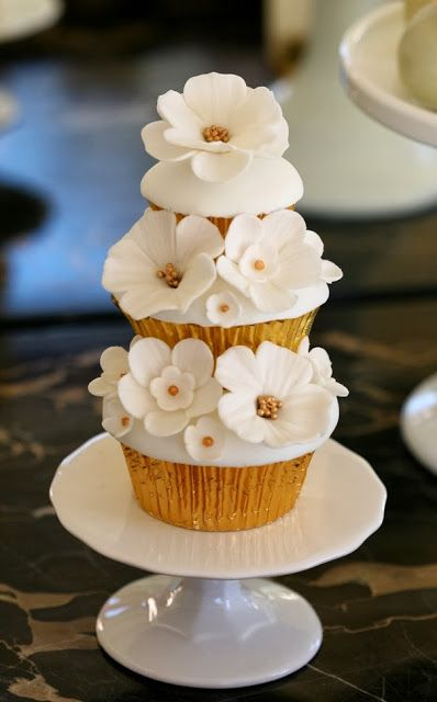 White Wedding Colors: Adorable three tier cupcakes! (Photographer unknown)