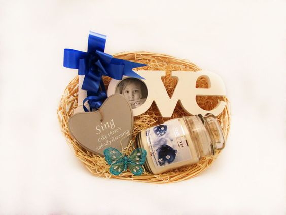 A beautiful 'Love' shaped photo frame, a heart shaped inspirational wall hanger and a scented soy candle in a glass jar with a lid make up this gorgeous Love Song basket! Perfect for the ladies in your life!  Price: 22.99  http://luxuryhampers.ie/p/love_song_basket