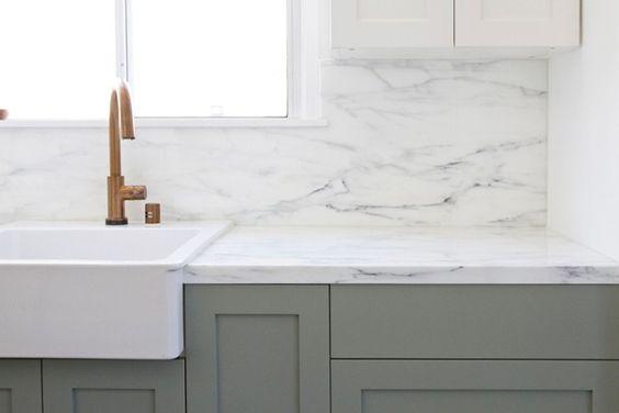 Ikea sink. White cupboards blend with wall. Darker cupboards below as contrast.