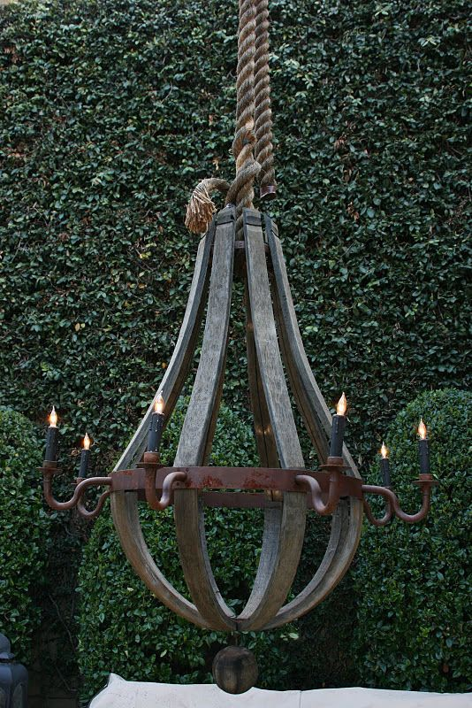 Rope hung forged iron chandelier garden accessories for Rustic outdoor chandelier