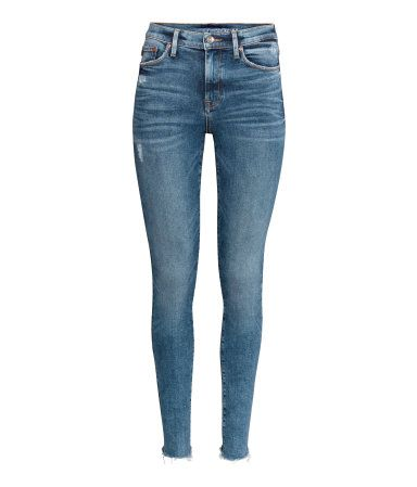Denim blue. Shaping. 5-pocket jeans in washed denim with technical stretch to trim and shape tummy, thighs, and seat, while jeans retain their shape. Skinny