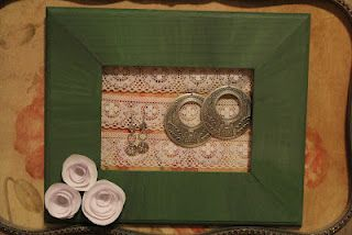 Picture frame (minus glass) with lace attatched across the opening makes a great earring display!