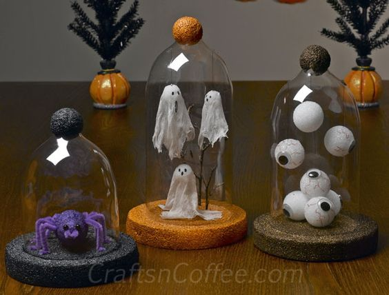 a trio of Halloween cloches you can DIY with plastic bottles.  These could be used for Christmas scenes.