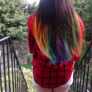 And if you're shy about a full rainbow head, you can always just add a few multicolor streaks to just the tips