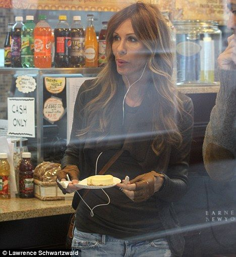 Casual: Author Carole Radziwill grabs a snack at a Manhattan cafe before her make-over