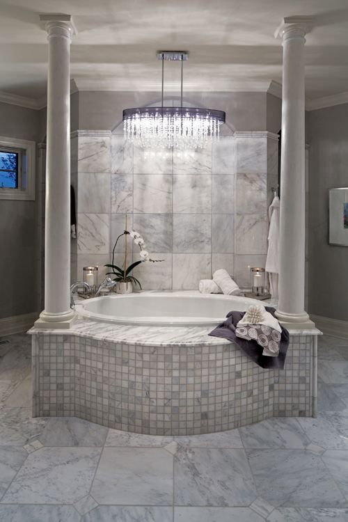 Indianapolis Monthly's 2012 Dream Home: An exclusive look inside the city's premier show home. A crisp color palette of mostly white-and-cream walls and furniture—with splashes of color throughout—complements the builder's architectural design. #bath #bathroom #bathtub