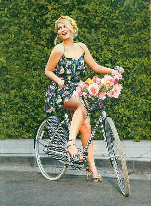 Meghan Trainor on a bicycle...Oooh! I like the design of the chain and spoke shield to keep skirts and dresses clean and not get tangled. I wonder who makes the bike, or can I get the shields to attach to the bike I have?