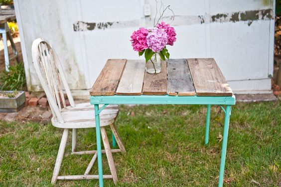 Aha!  I knew someone had probably done this!  Scored a cool old wooden card table sans top. Already asked DH to cut me some of our thinner pallet boards to make one (to fit inside frame which I prefer to this look).....frame is an awesome vintage green so I'm thinking a multi-colored paint or even stain for the boards.  Gotta finish 4 paying projects first before doing this one for me,  LOL!