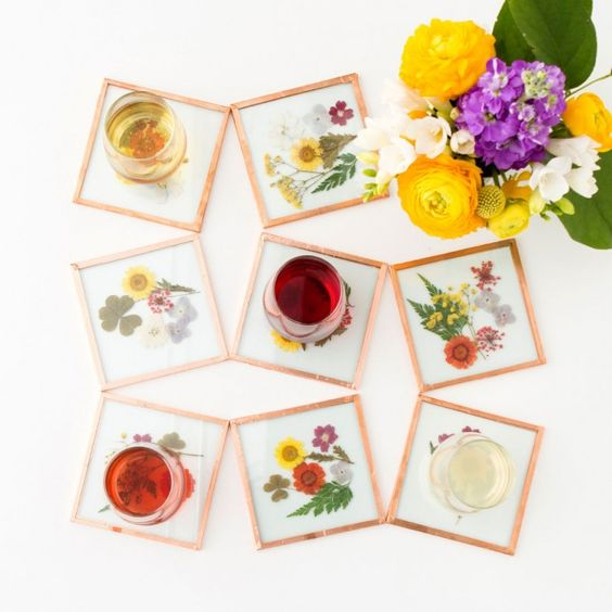Save this easy DIY project to make a set of pressed flower coasters to gift to your mom on Mother's Day.