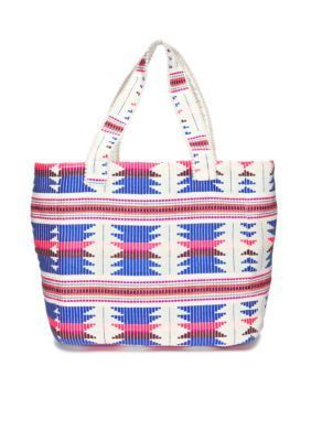 This bold multicolored embroidered tote bag features small pom fringe around the hand straps, built-in shaping in the bottom of the bag, and plenty of space for carrying your essentials.