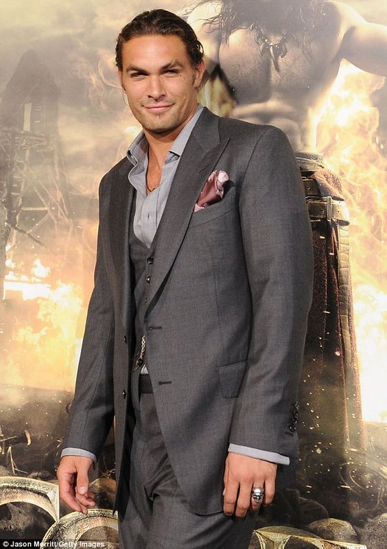 ......the most beautiful man on earth wearing his grey silk suit with
