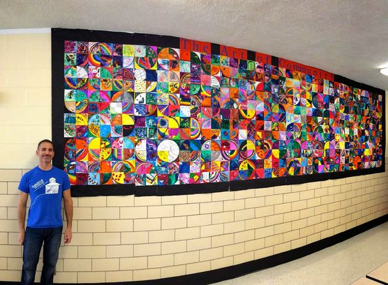WOW!  Give each student in the school 1/4 of a circle and then put them all together to make this mural!